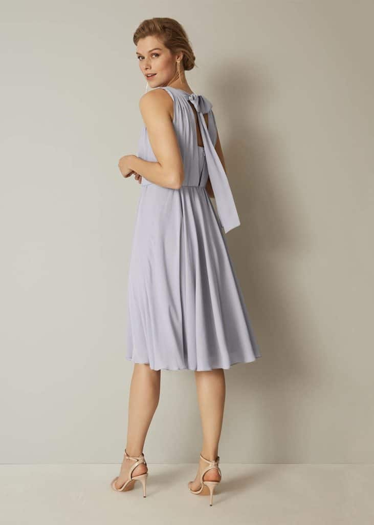 Pale blue tie back dress with fitted bodice and flare skirt for bridesmaid or mother at a wedding
