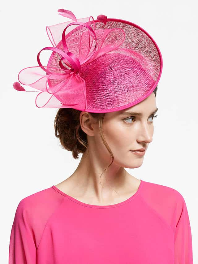 Hatinator in fuschia pink with upturned brim and bows and feathers decoration for a Mother of the Bride or Groom