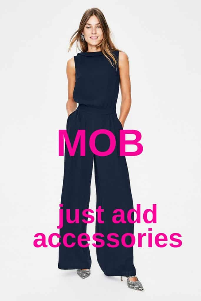 Navy sixties style neckline for this super Mother of the Bride jumpsuit.