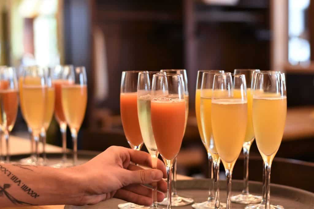 Mimosas and bellinis in stemmed flutes at a wedding