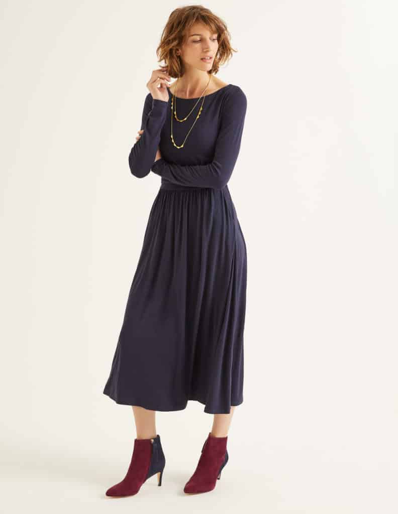 Boden Lucille dress in navy with boat neck, long sleeves and gathered full skirt