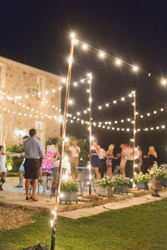 Guests dance outside on a rustic wood floor