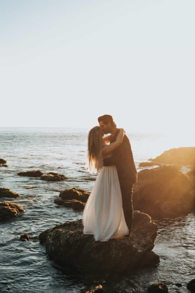 Wedding couple kiss on a loch