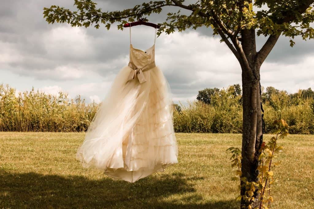 A wedding dress blowing in the breeze outdoors