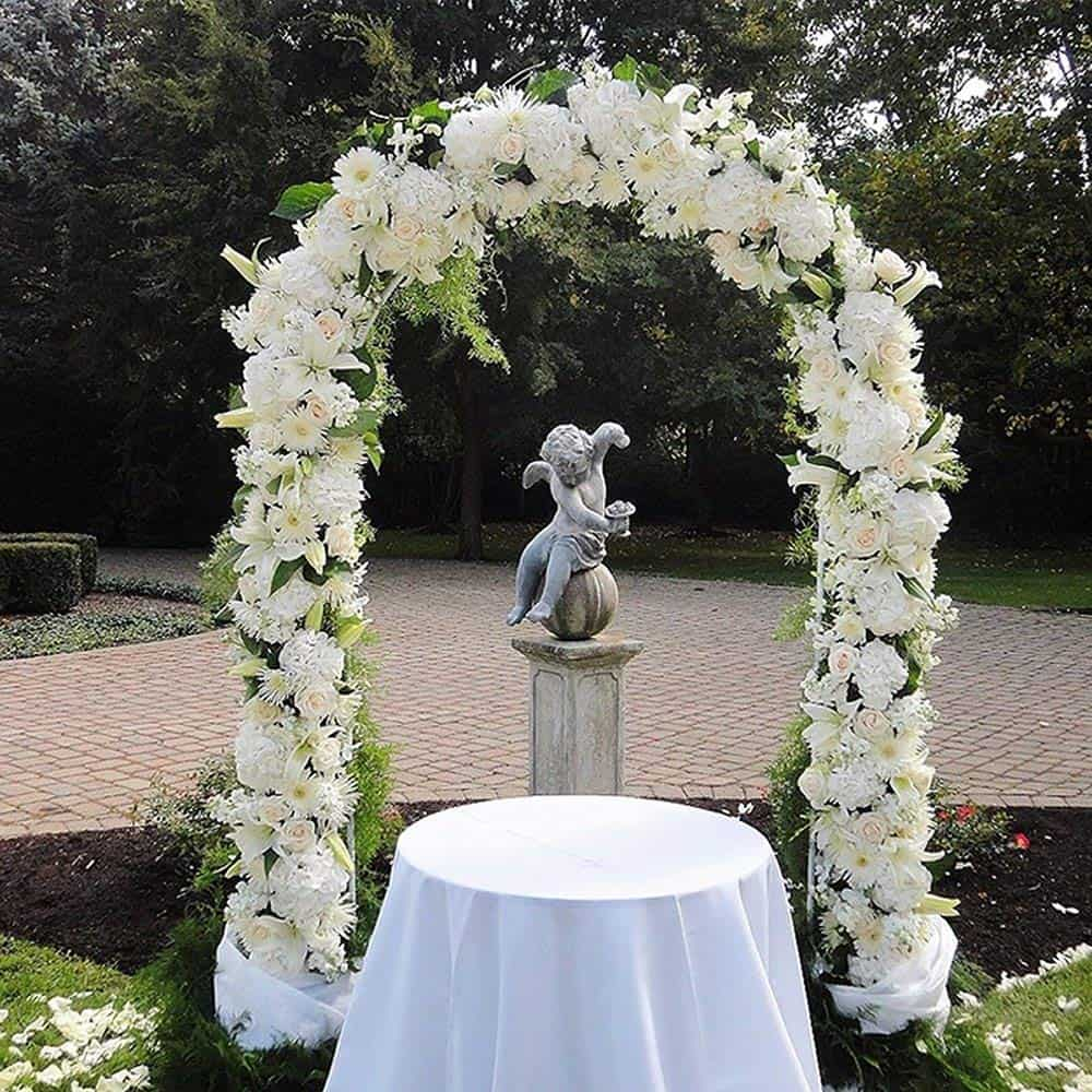 A lightweight metal tubing arch supports flowers and ribbons to form a beautiful frame at the wedding