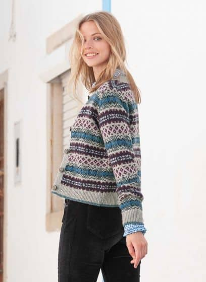 Grey and blue fair isle cardigan by Brora worn with velevet pants