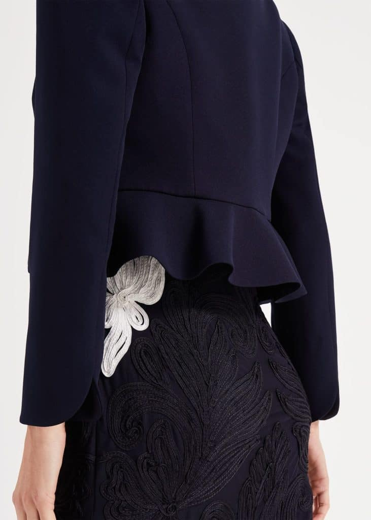 Phase Eight Caroline peplum jacket in navy worn over the Catheleen dress.  Rear view.
