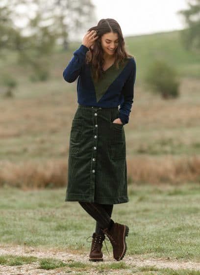 Brora corduroy skirt in green worn with patterned tights and hiking boots