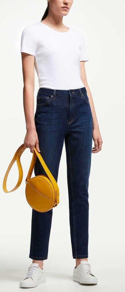 Mid to dark wash denim jeans cut Mom style with high waist