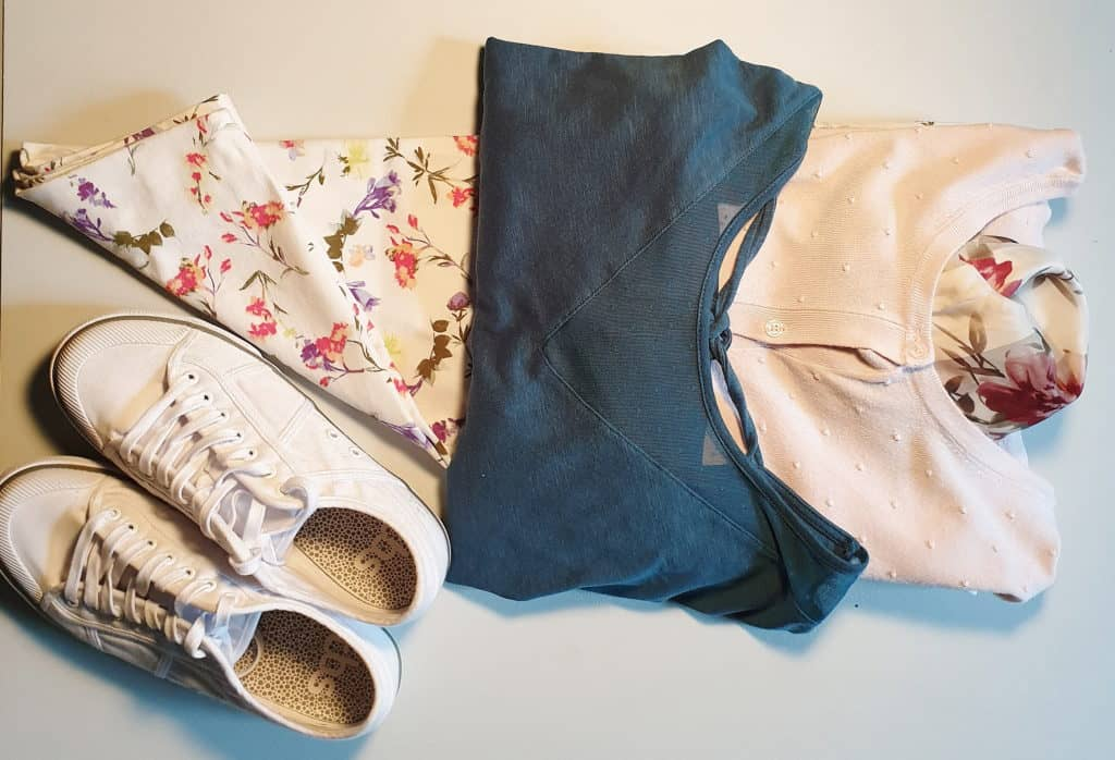 Capsule outfit with green tee with floral pants and pink cardigan
