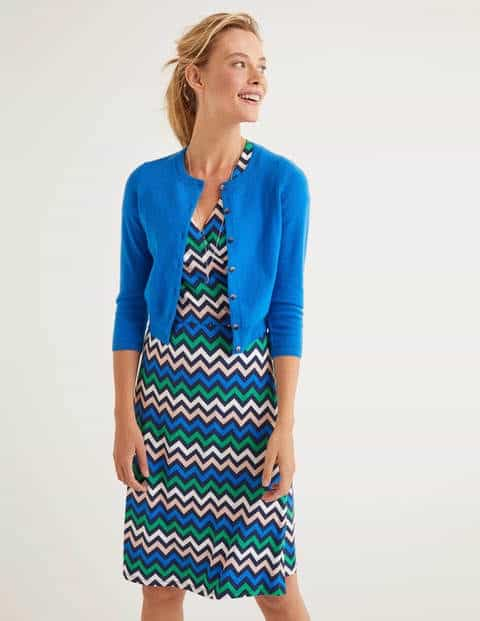 Boden short cashmere crew neck cardigan worn with dress