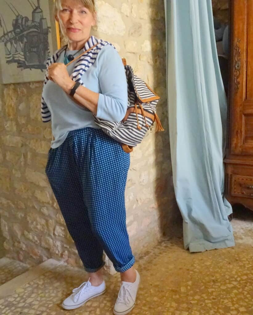 This stripey backpack in navy and white goes with the blue trousers and pale blu tee