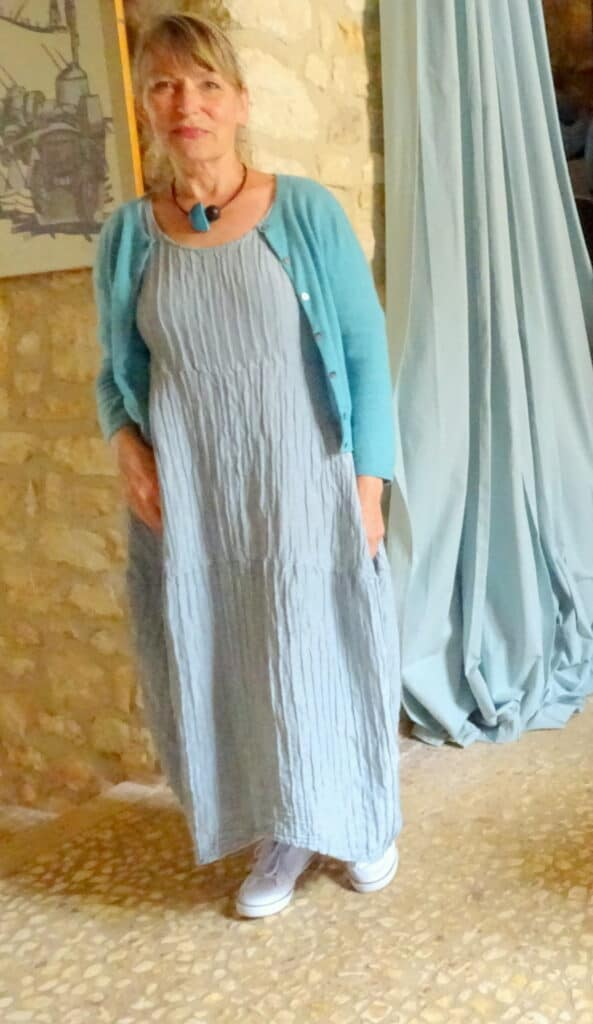 Midi greenish blue dress with white sneakers and green cardigan complete my spring wardrobe