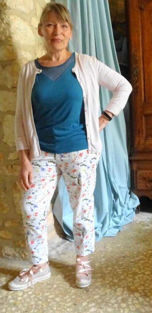 Patterned pants go with green top and pink cardigan and sneakers for my capsule wardrobe