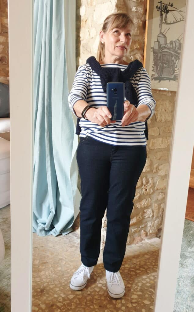 Selfie in mirror showing my Capsule Wardrobe base colors of navy and white