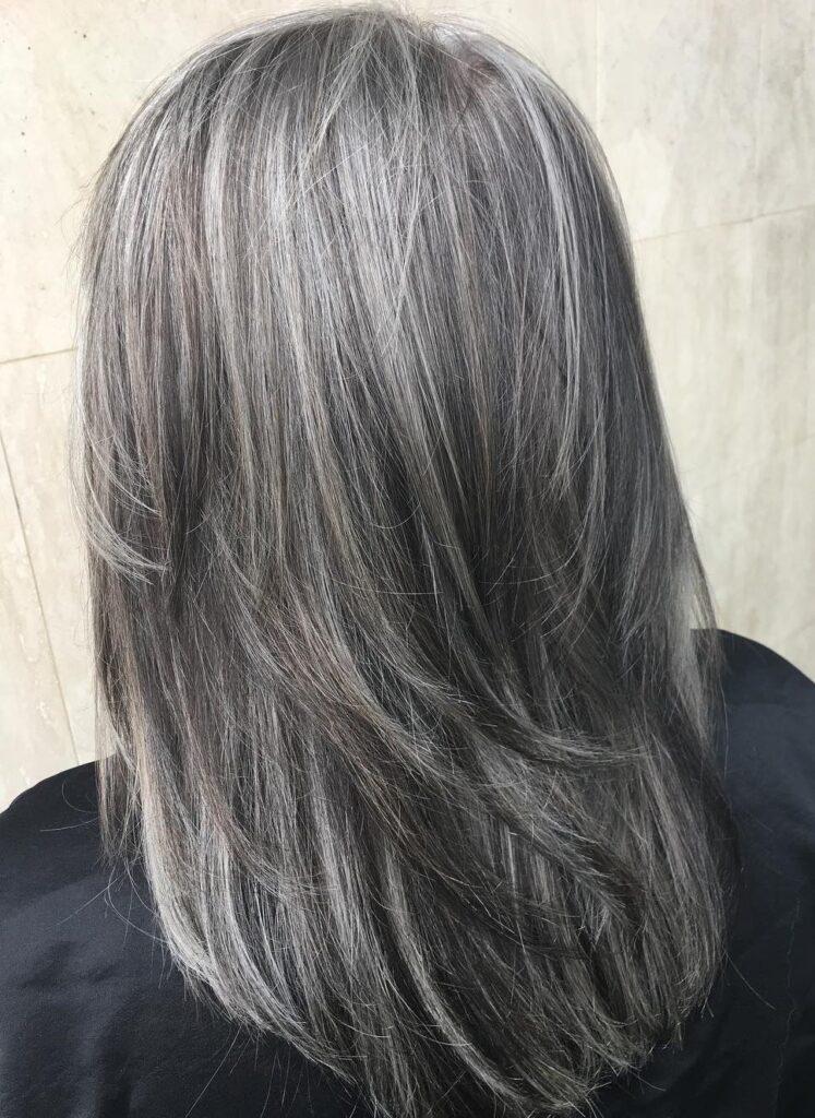 Long sleek grey highlighted hair style