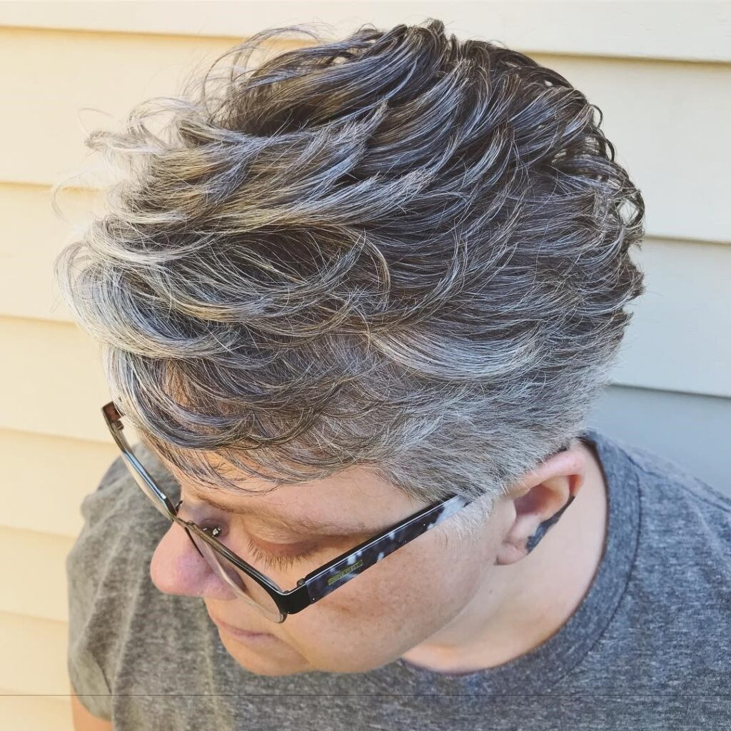Sharp haircut with top waves and shorn back gray hair