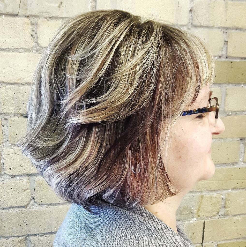 Highlights and lowlights add texture and body to this mid length hair.