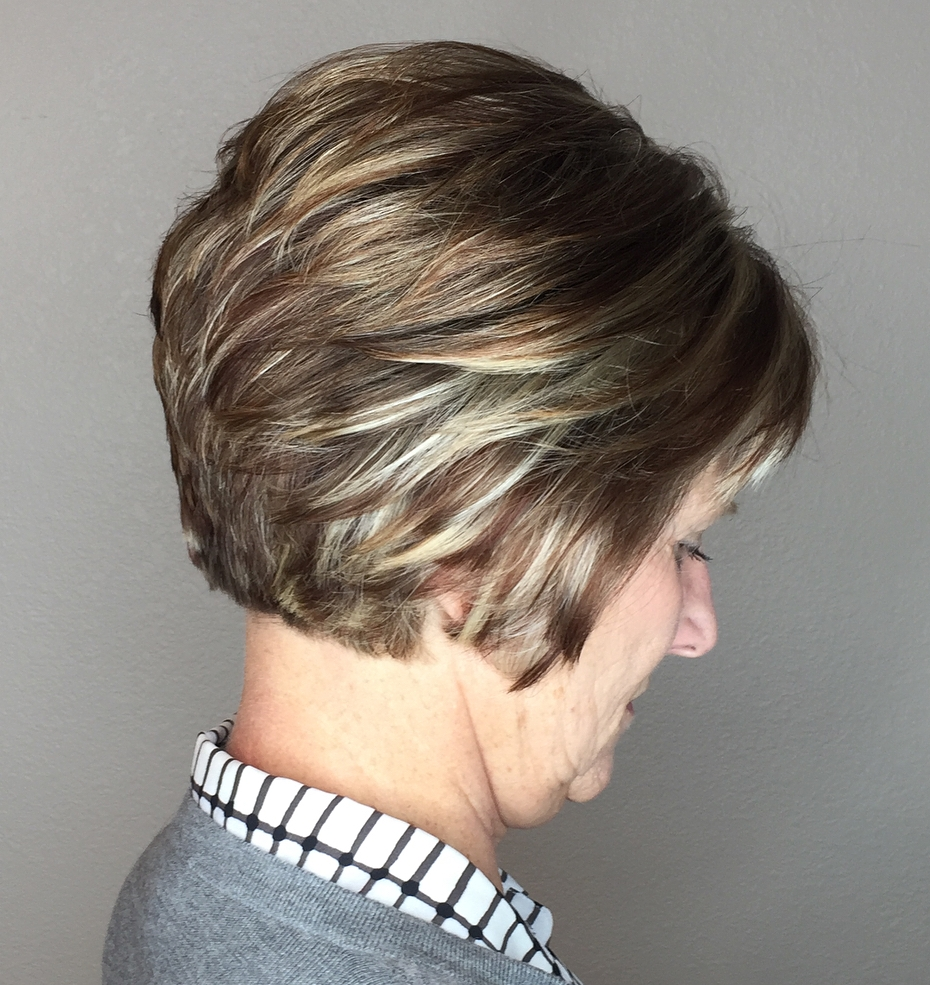 Neat hairstyle with layered short bob ideal for woman over 60