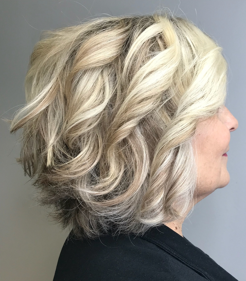 Hair style for over 50s twists and curls blondish gray
