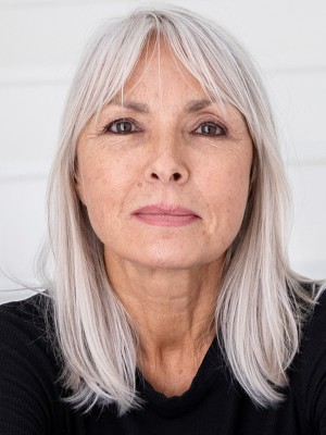 Long naturally styles silver hair on woman over 60