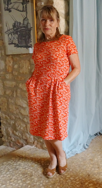 Orange print dress from Boden with chunky gold necklace