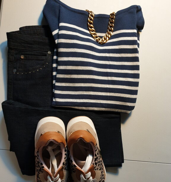 A navy and tan outfit coordinated by color