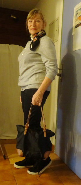 Boden cashmere cardigan over straight cut black trousers with black nylon bag and velour black sneakers