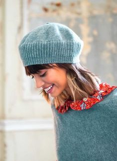 Knitted beret by Brora in cashmere color blue-green