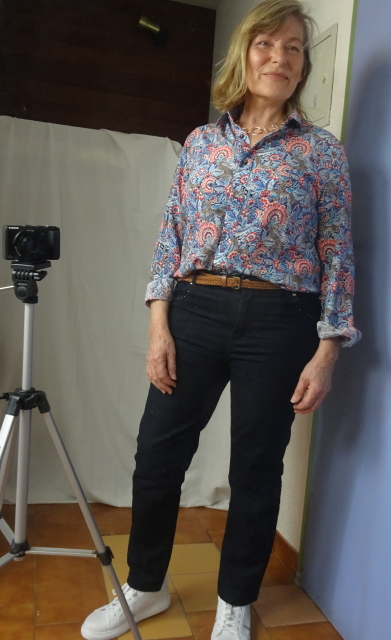 The Brora silk shirt in blue and orange with dark wash jeans