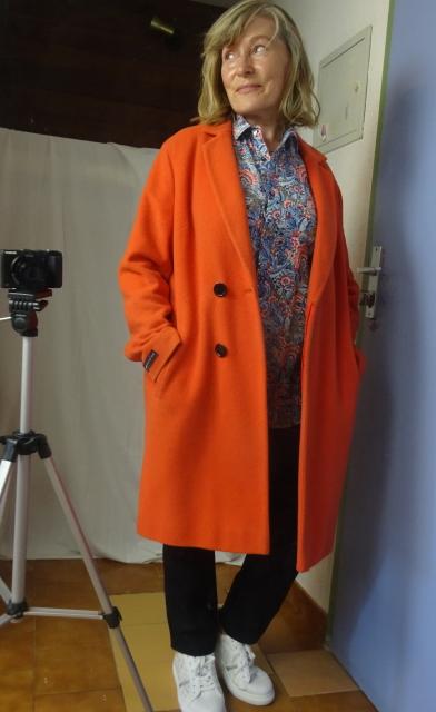 Orange wool and cashmere coat over blue and orange Brora shirt