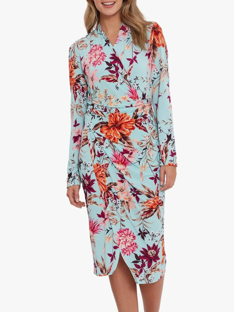 A stylish wrap dress over the knee midi length.  Large floral design, long sleeves, ruched waist and hip features by Gina Bacconi at John Lewis.