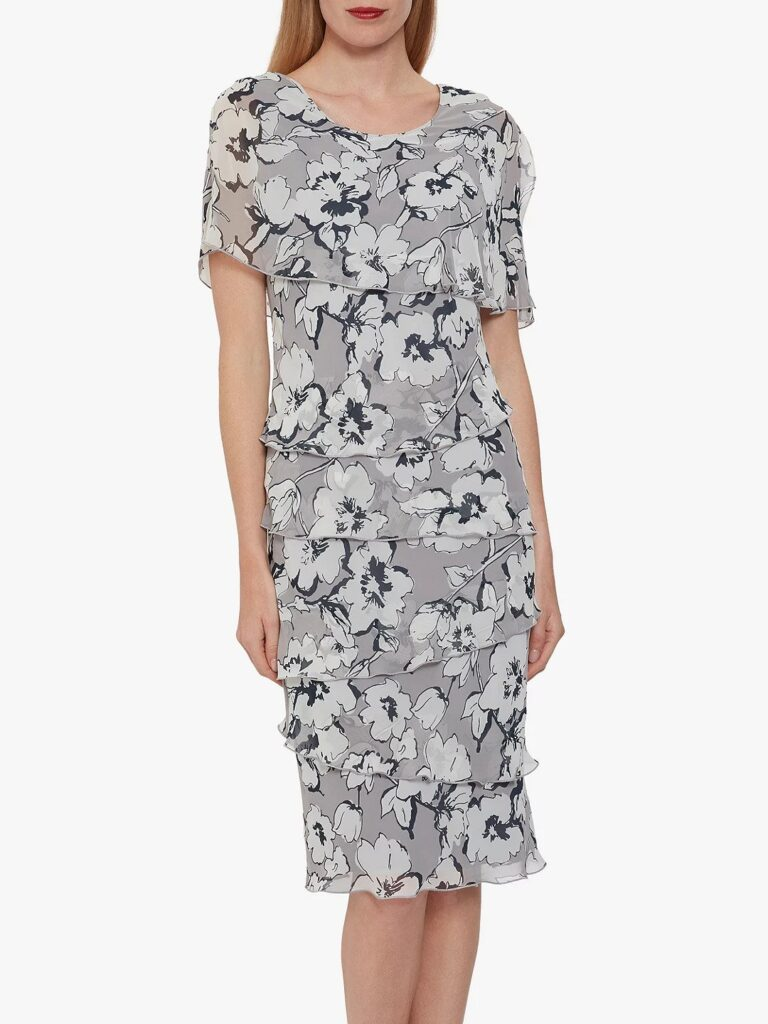 Black and pale grey large flowers printed on a chiffon dress with multiple tiers and  covered arms by Gina Bacconi at John Lewis